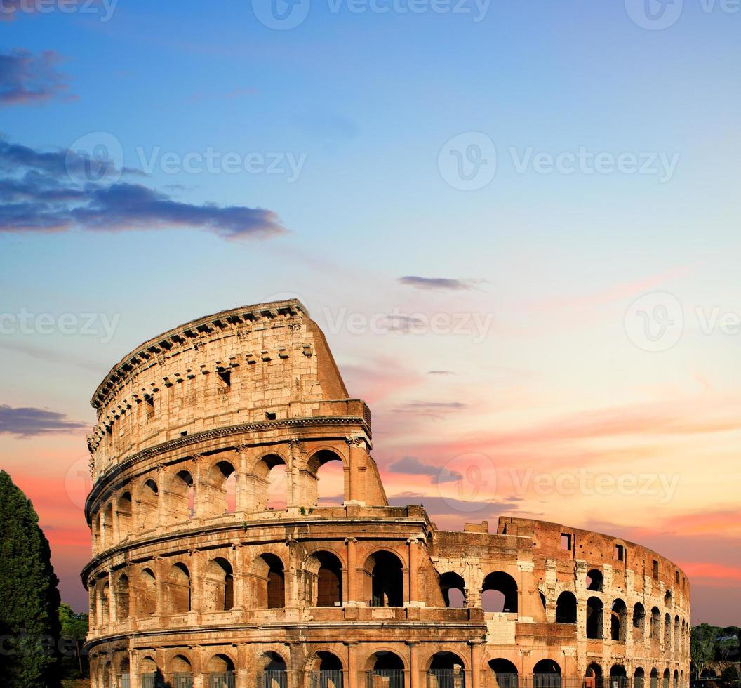 Colosseum at sunset in Rome, Italy photo