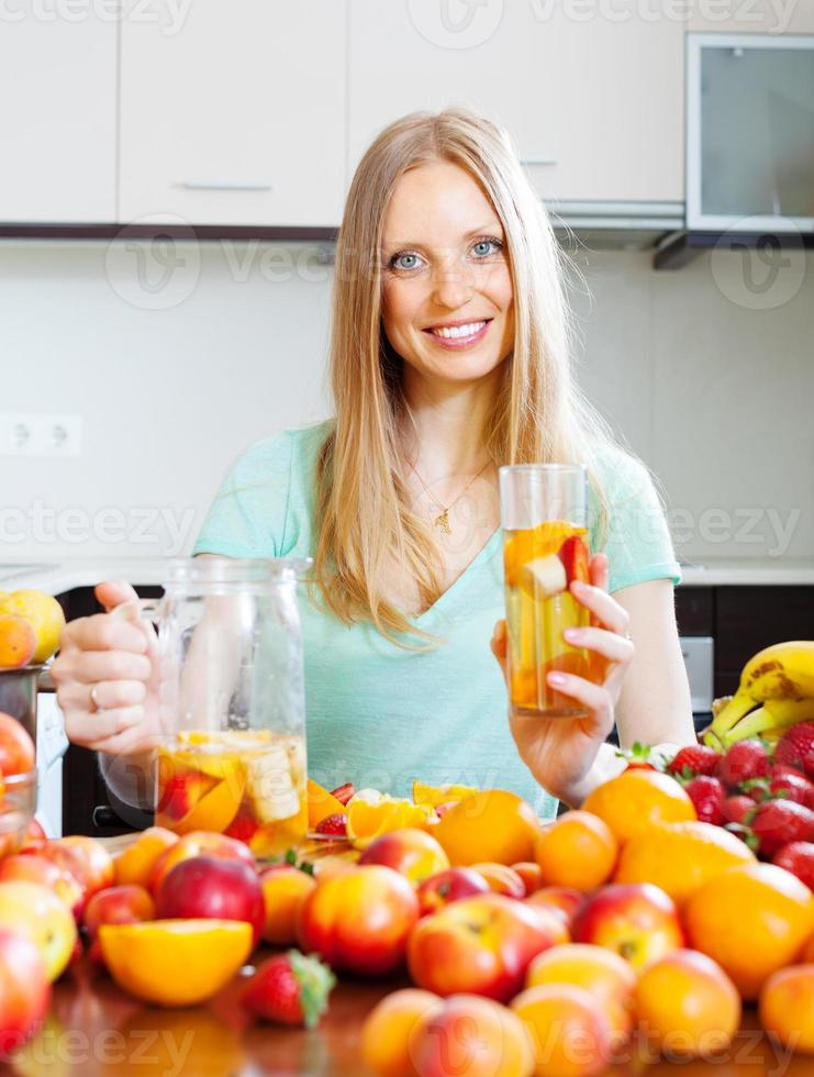 cheerful woman with fruits beverage photo