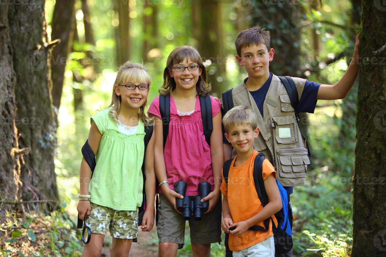 Portrait of four kids with camping gear photo