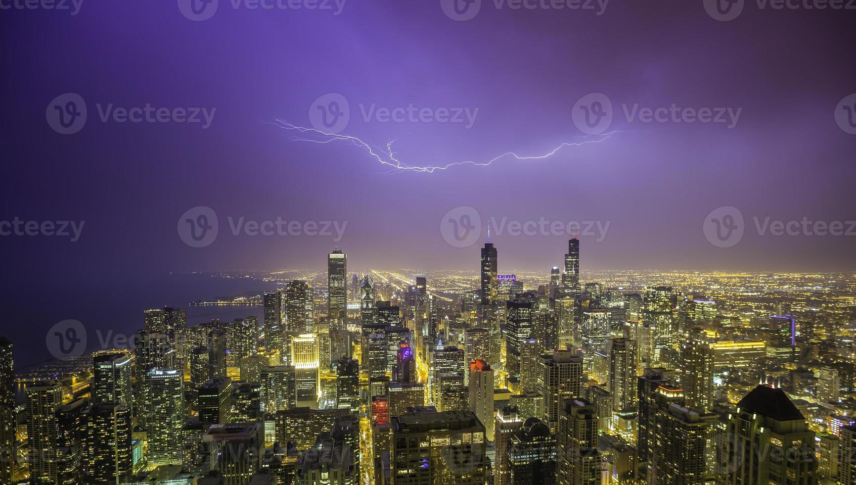 Chicago downtown night panorama during thunderstorm photo