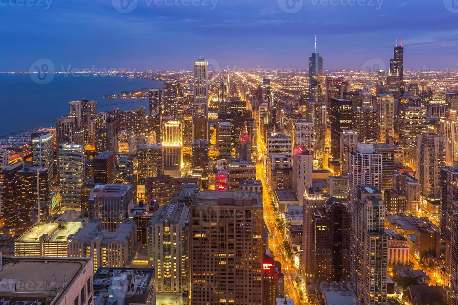 The bustling Chicago downtown skyline at night in Illinois photo