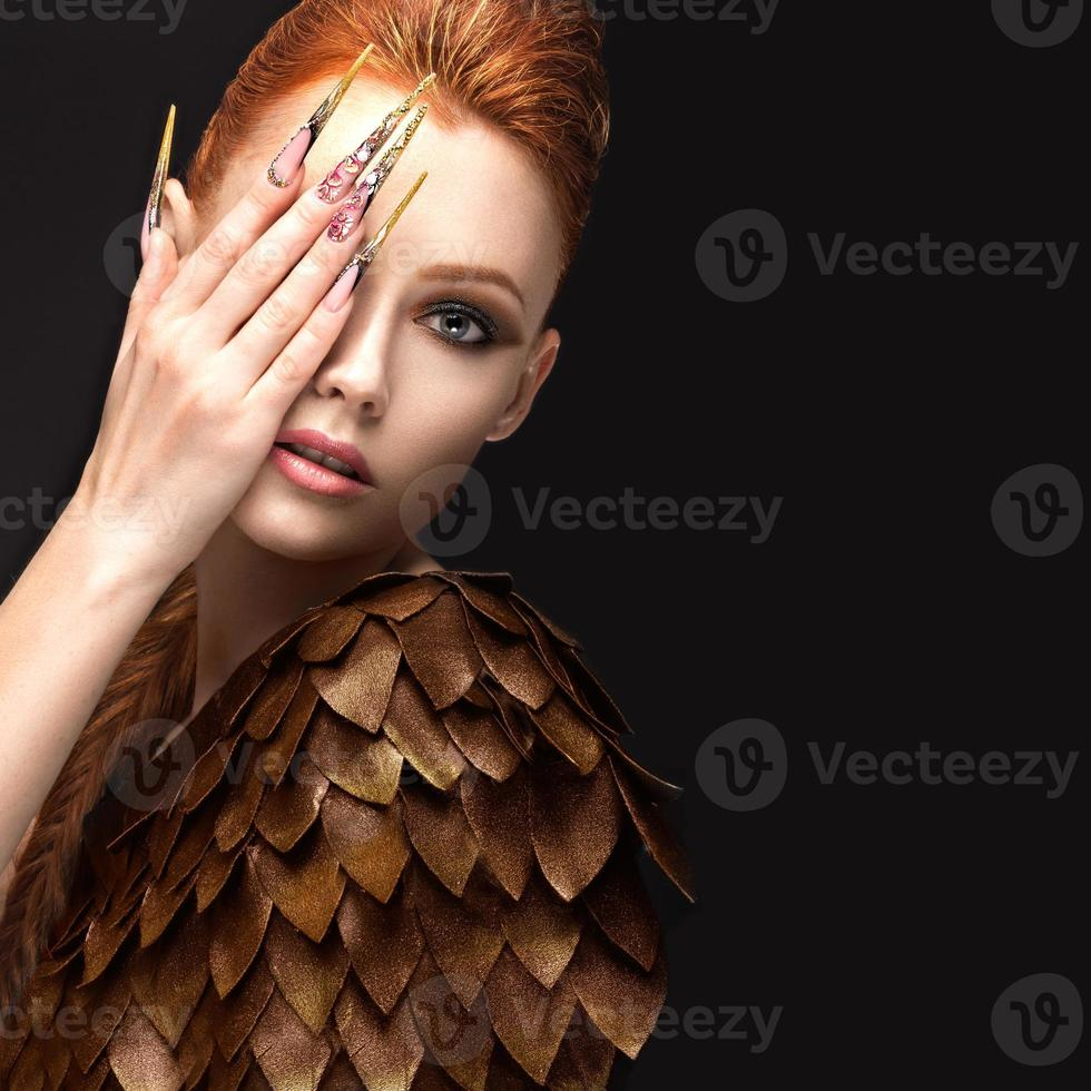 Beautiful girl in the image of the Phoenix photo
