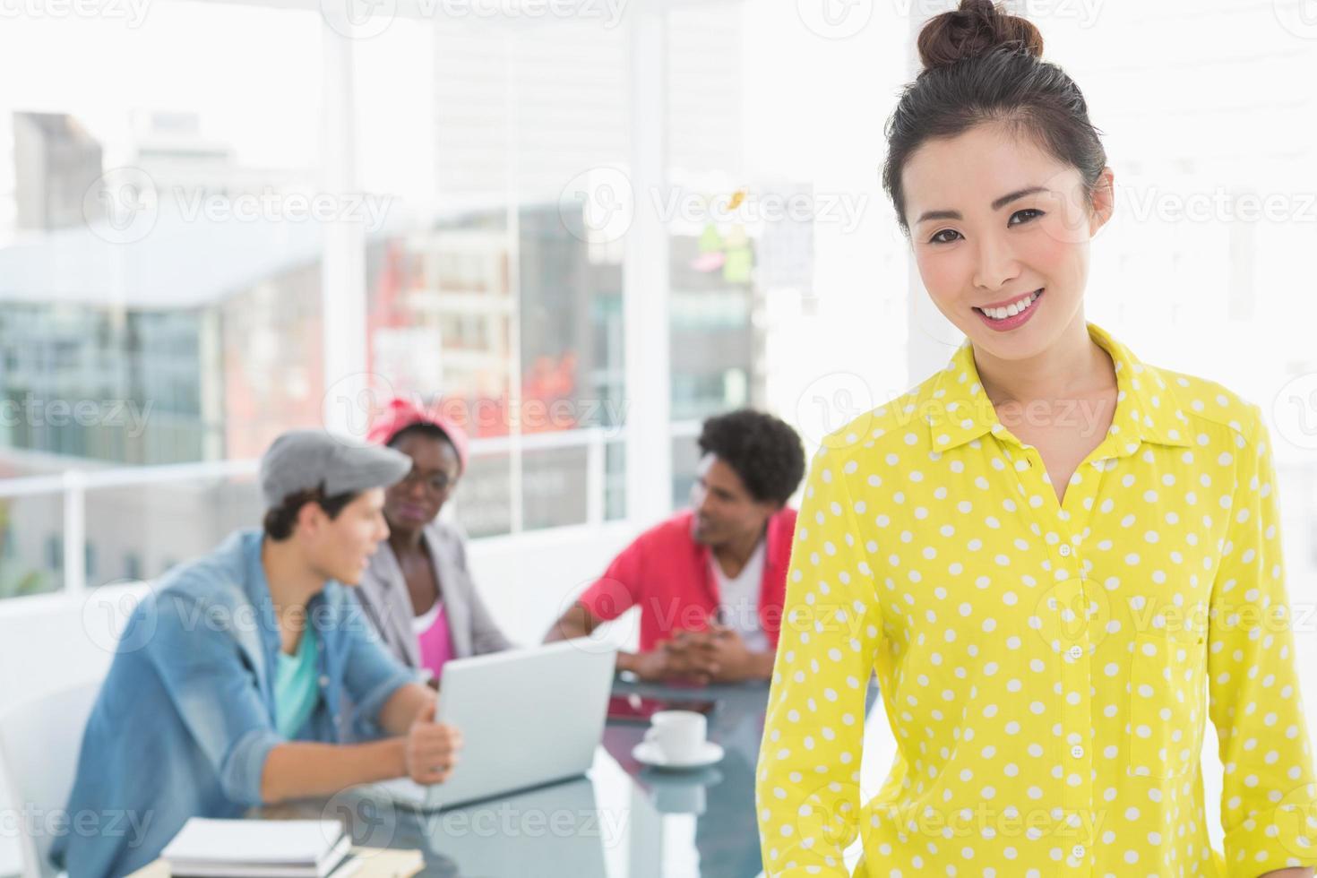 Young creative woman smiling at camera photo