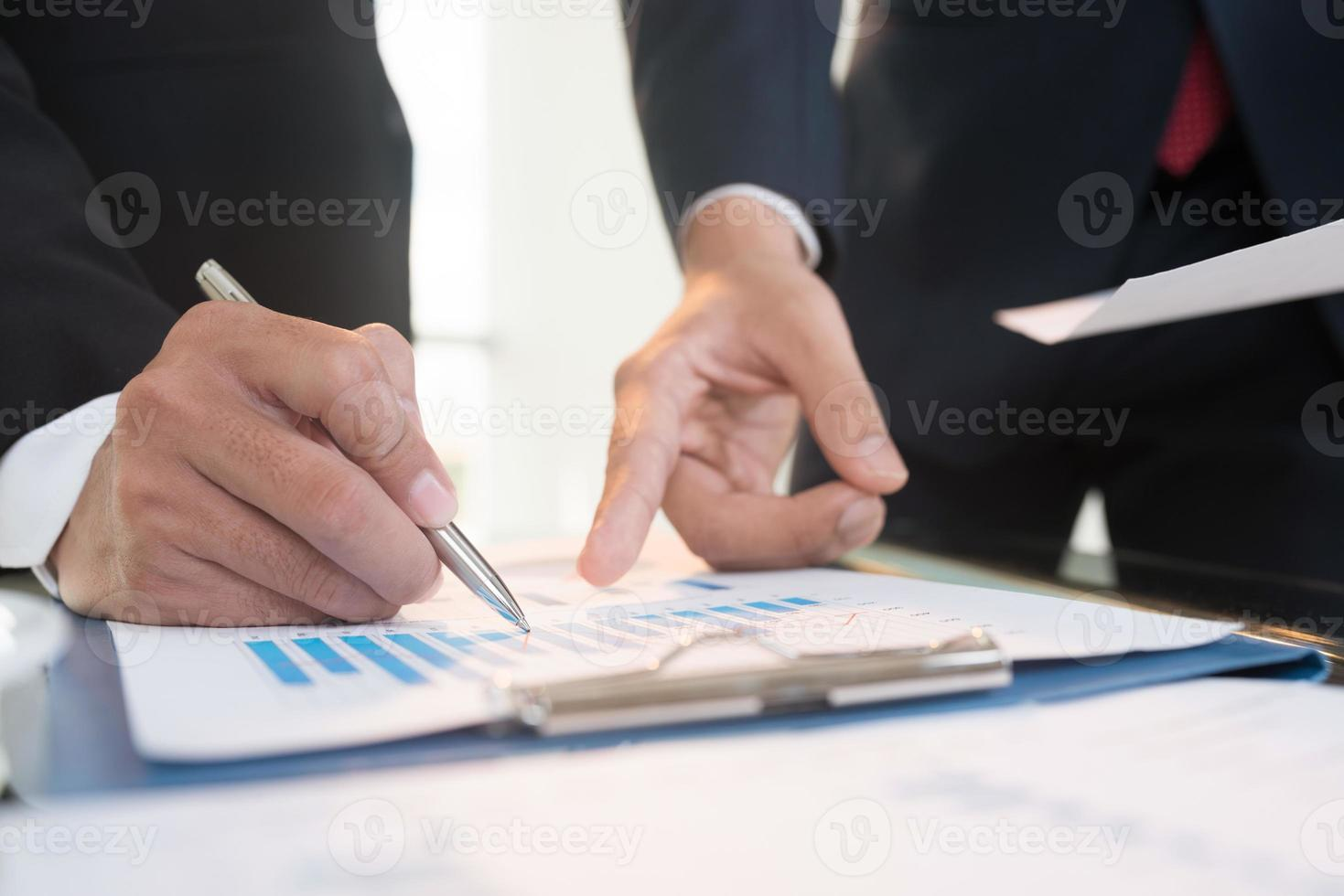 Discussing financial document photo