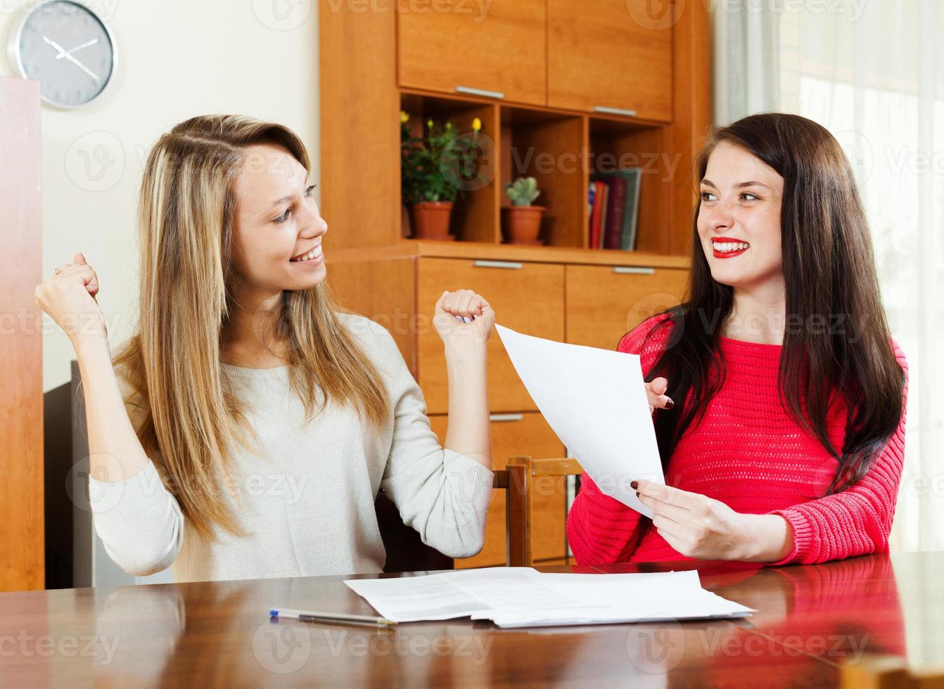 Happy women with financial documents photo