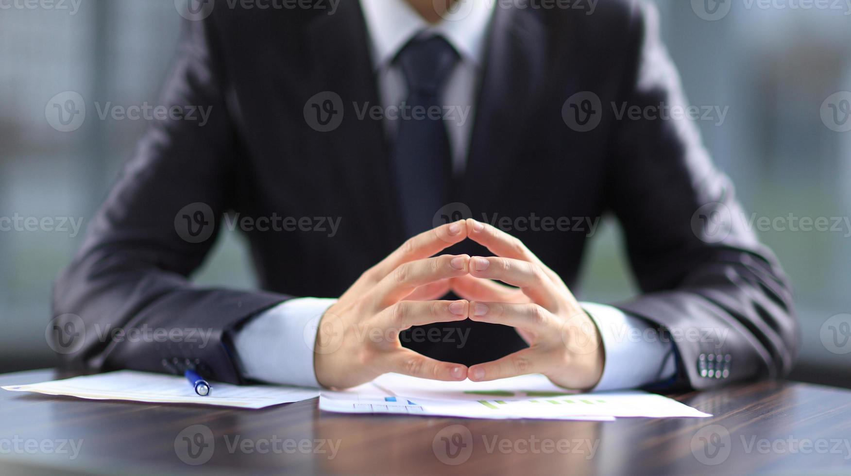 Businessman working with documents in the office photo