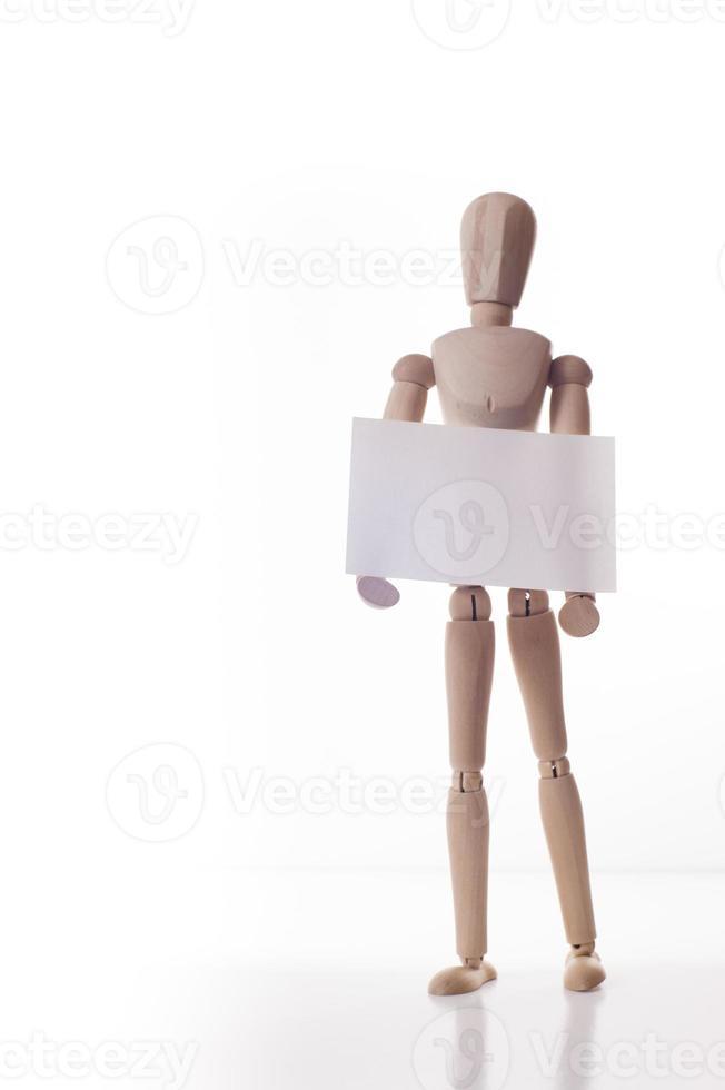 wooden manikin holds message board photo