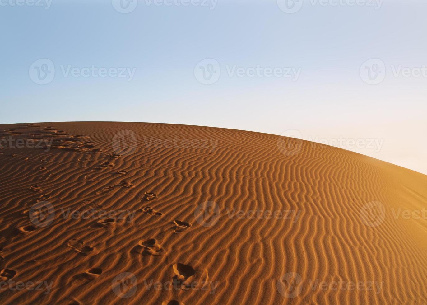 sunset over Sahara desert photo