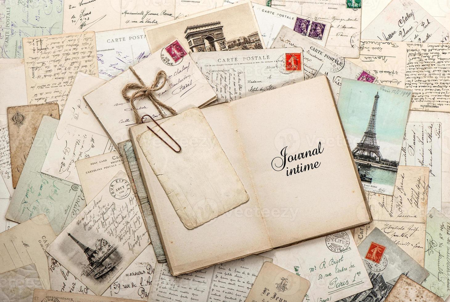 open empty diary book, old letters, french postcards photo