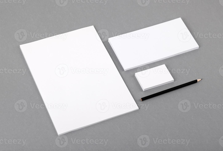 Blank basic stationery. Letterhead flat, business card, envelope, pencil. photo
