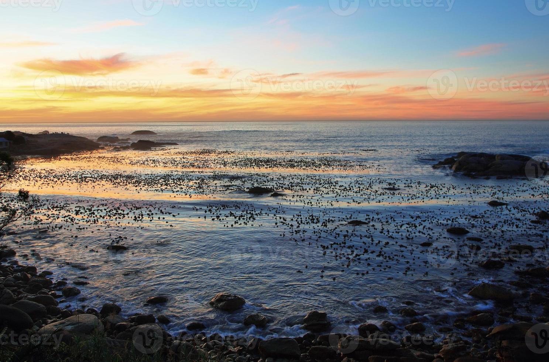 Sunset in idyllic beach near Camps bay photo