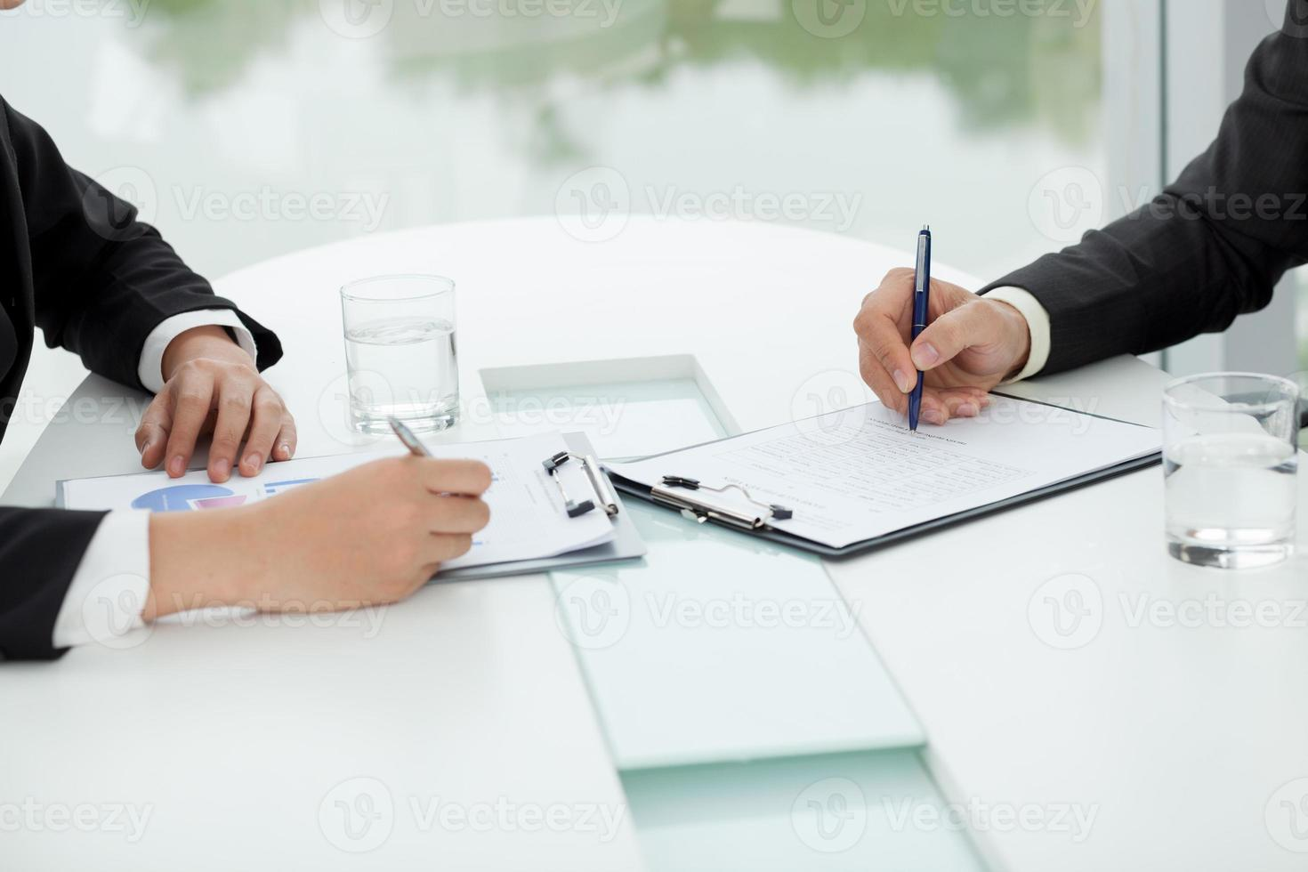 Discussing financial documents photo