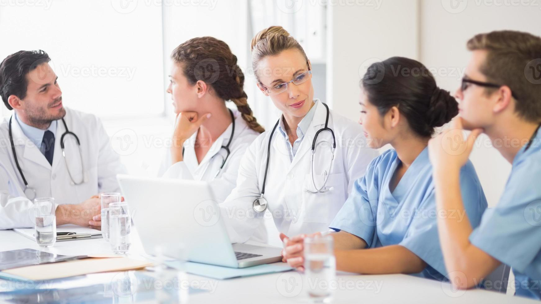 Medical team discussing photo