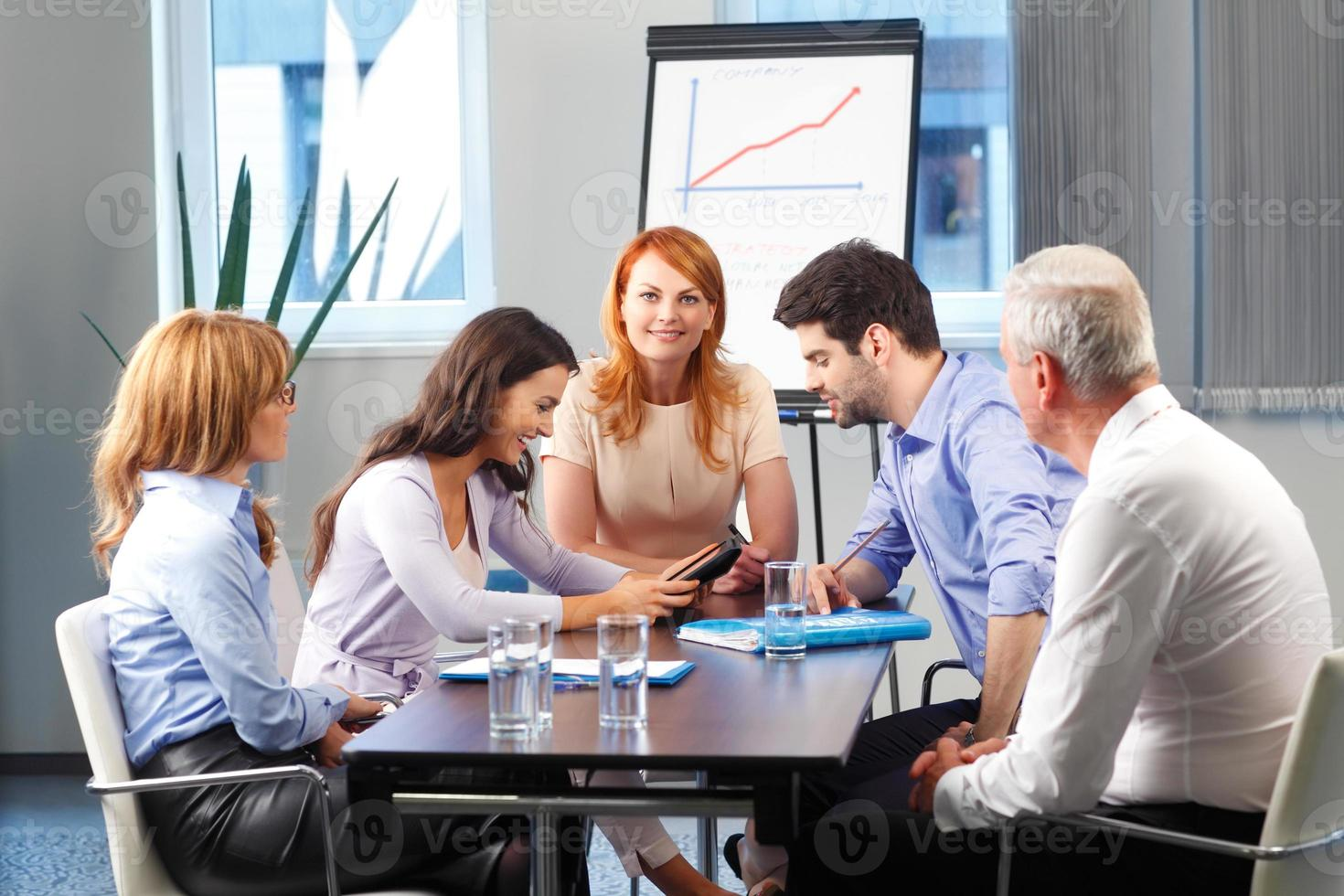 Business people discussing at meeting photo