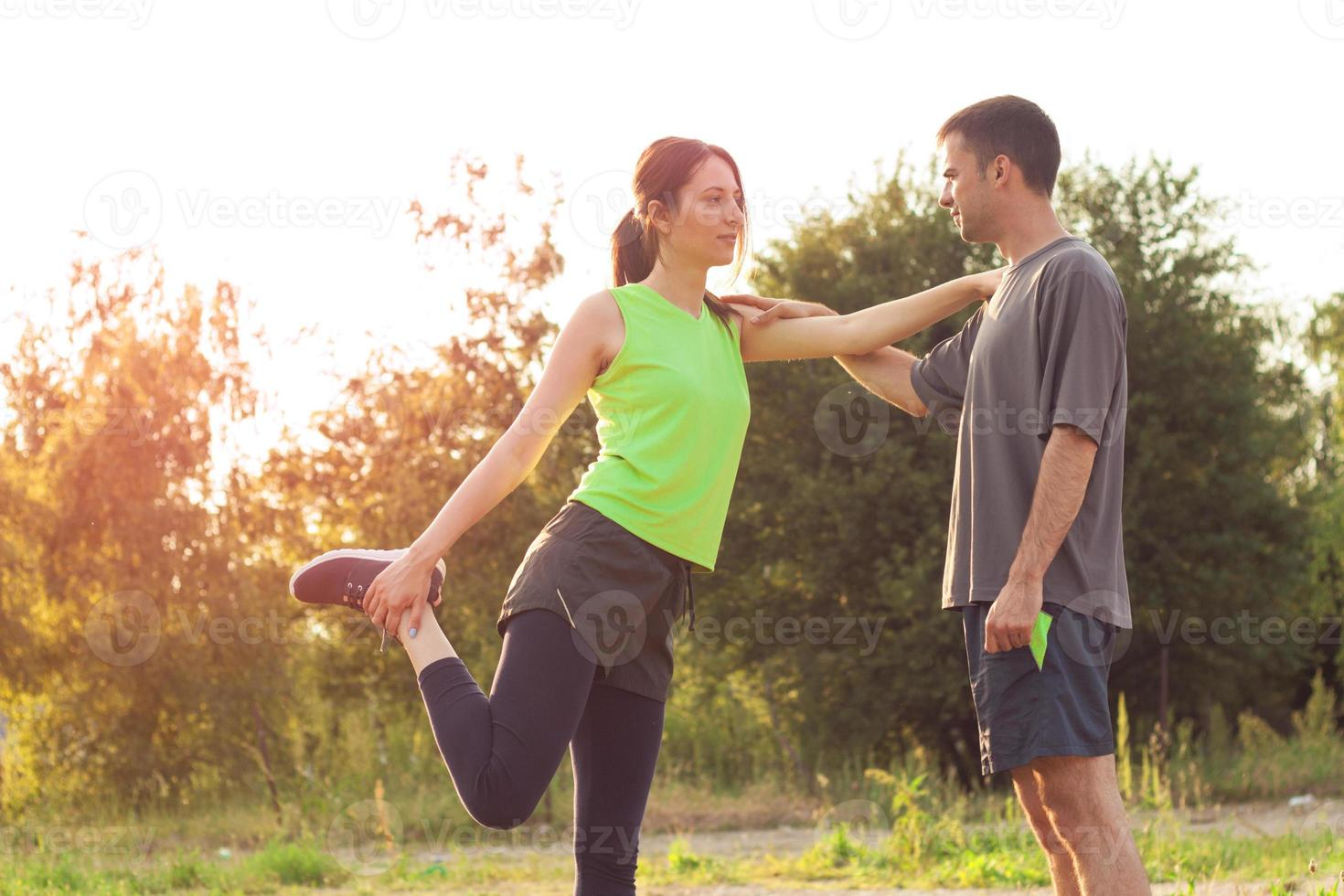 couple exercisin together photo