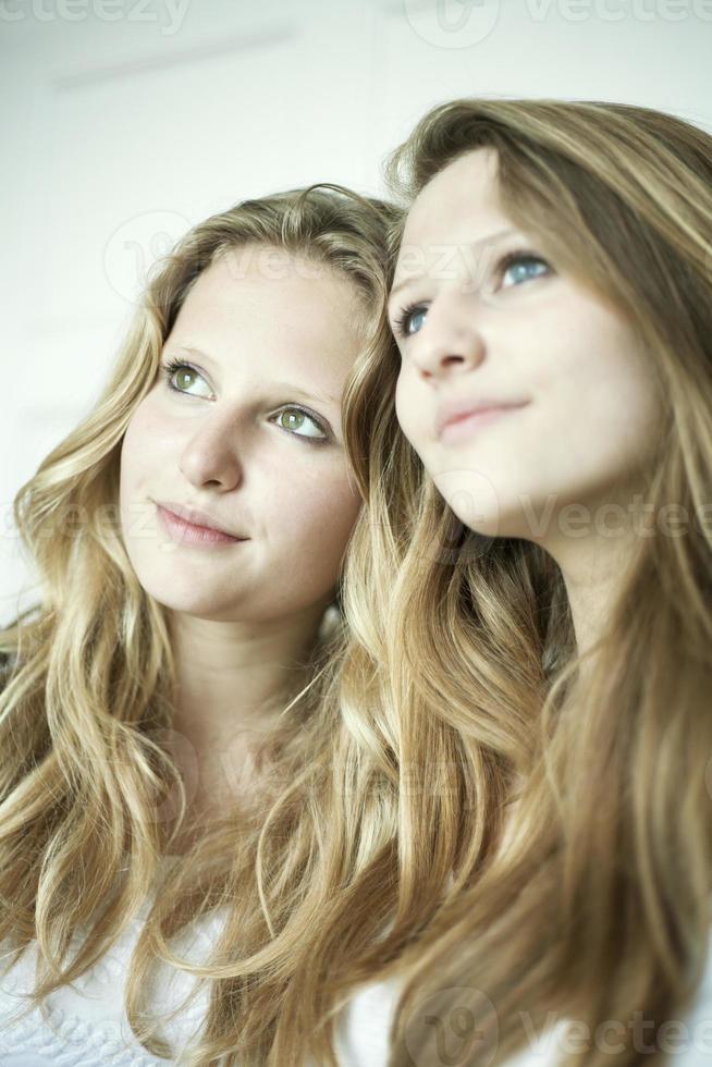 Teenage girls smiling together photo