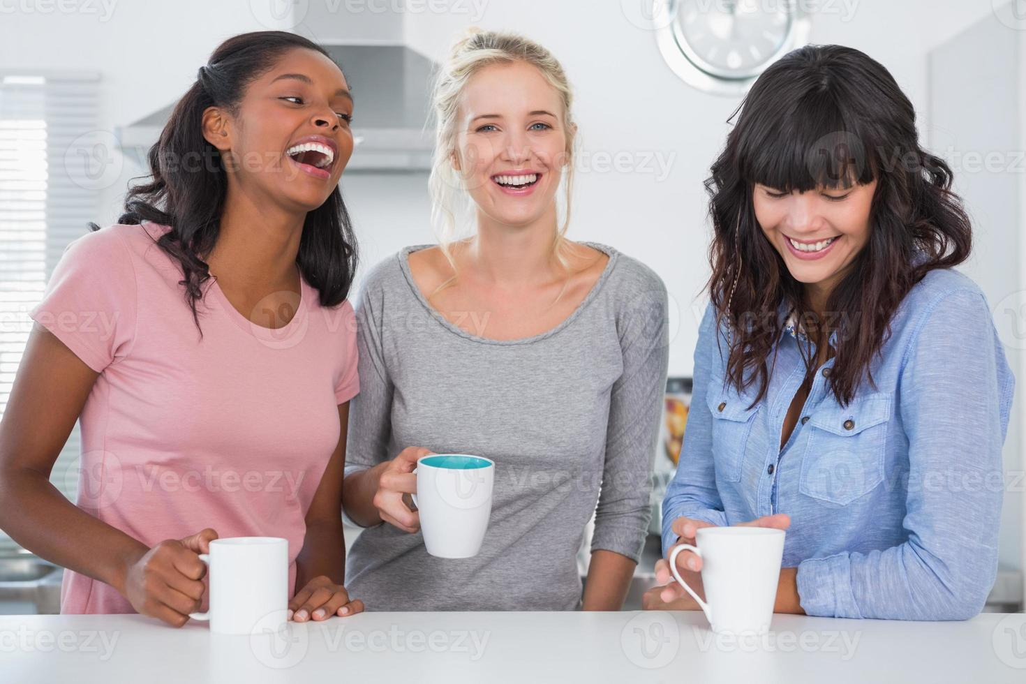 Happy friends having coffee together photo