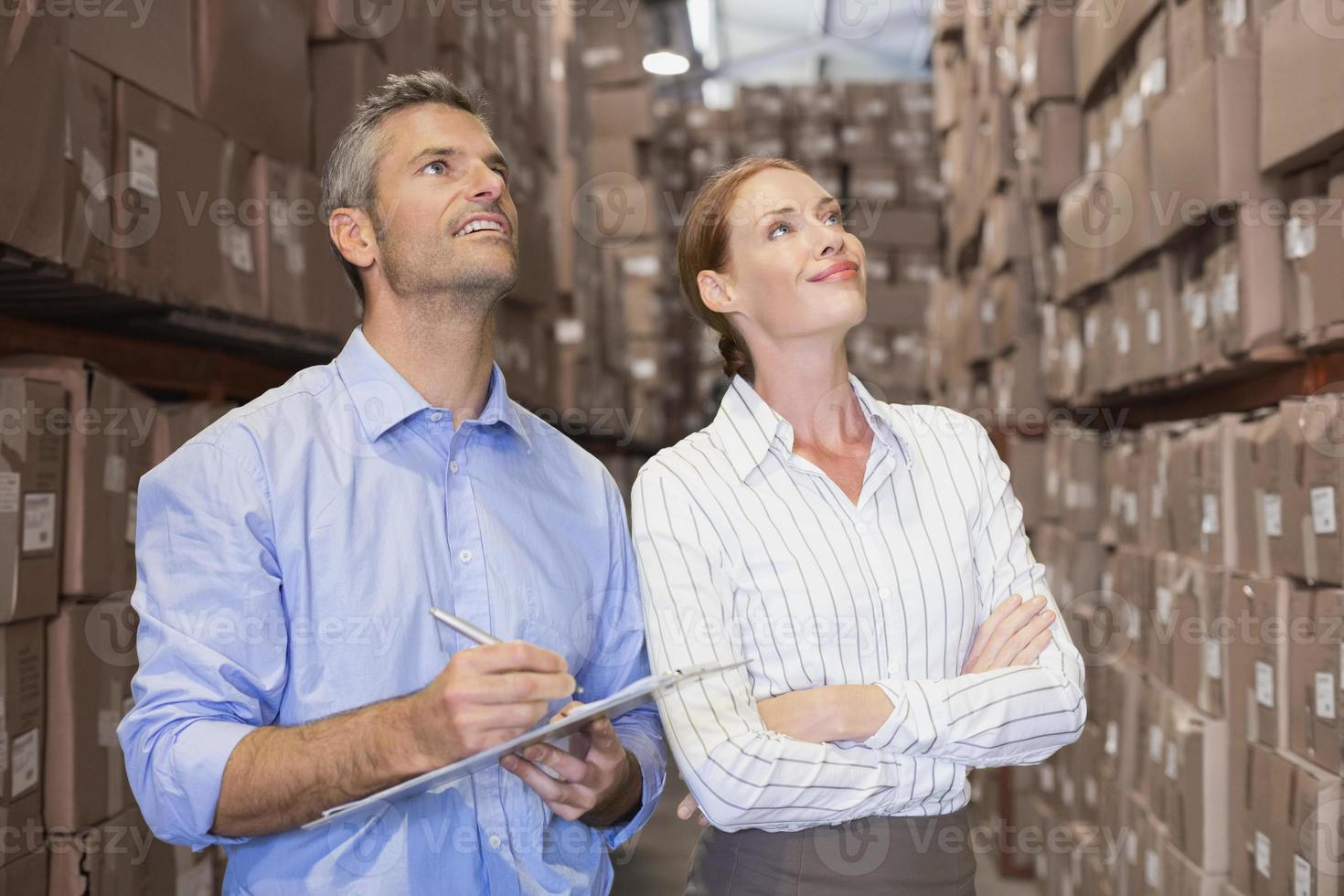 Warehouse team working together with clipboard photo