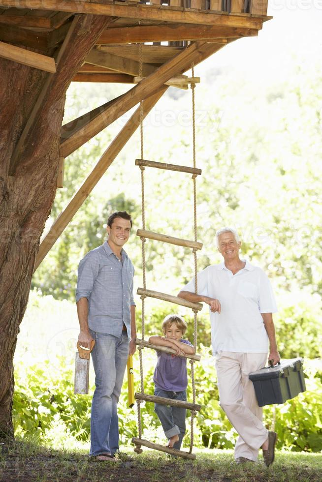 Grandfather, Father And Son Building Tree House Together photo