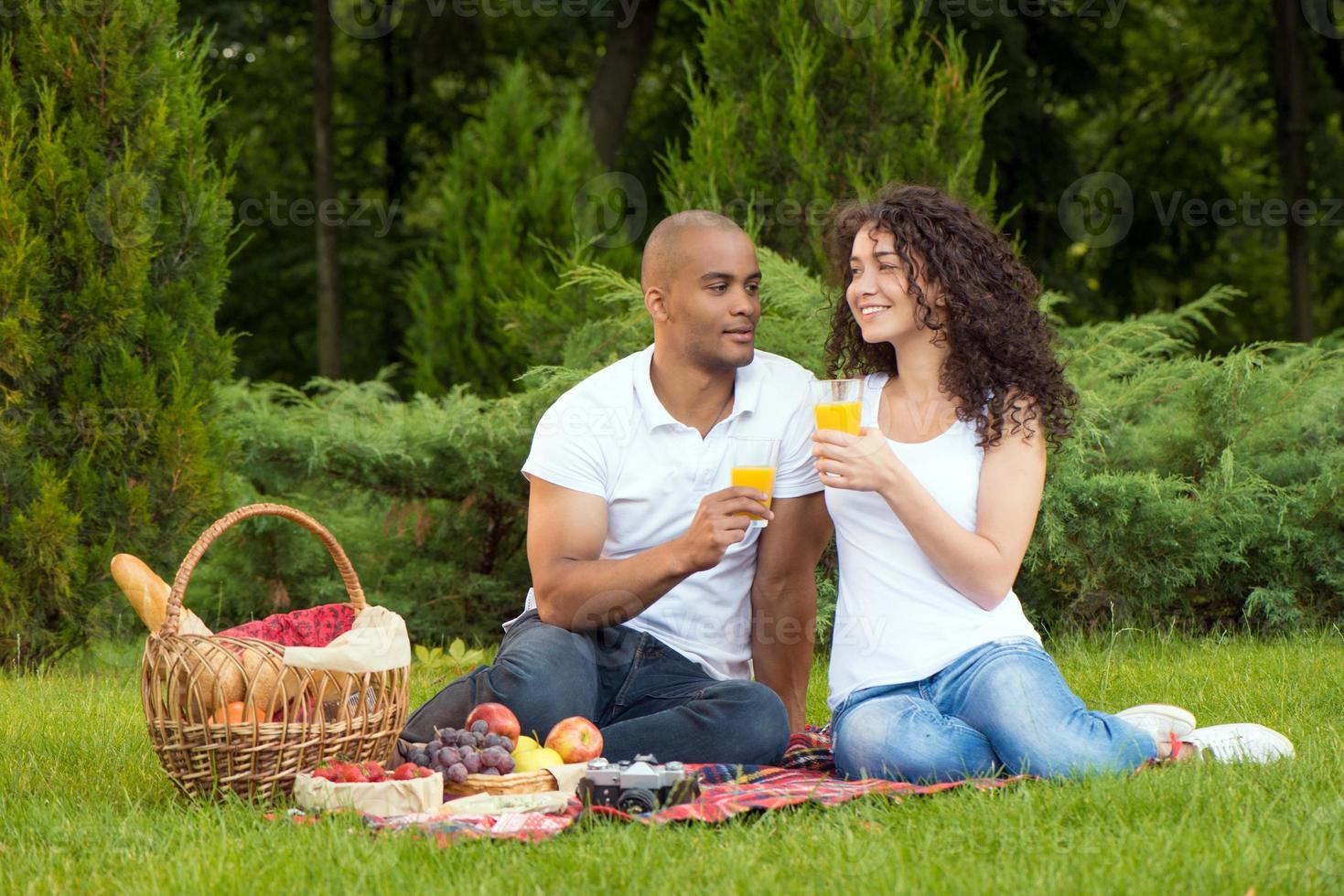 Happy young couple spending time together in park photo