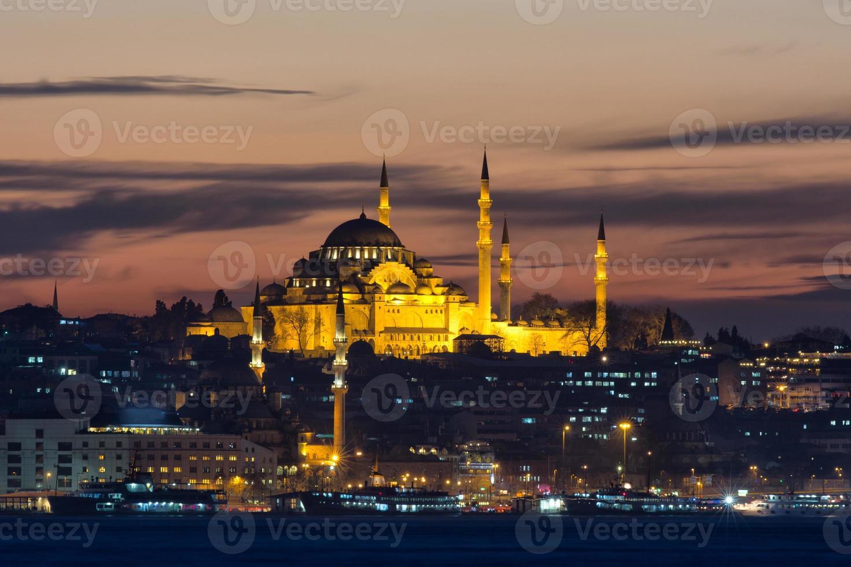 Moschea Suleymaniye alla notte di Istanbul foto