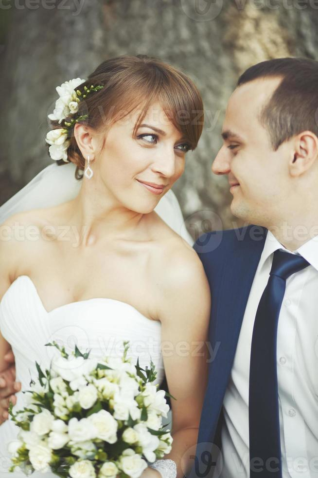 Young wedding couple  in park together photo