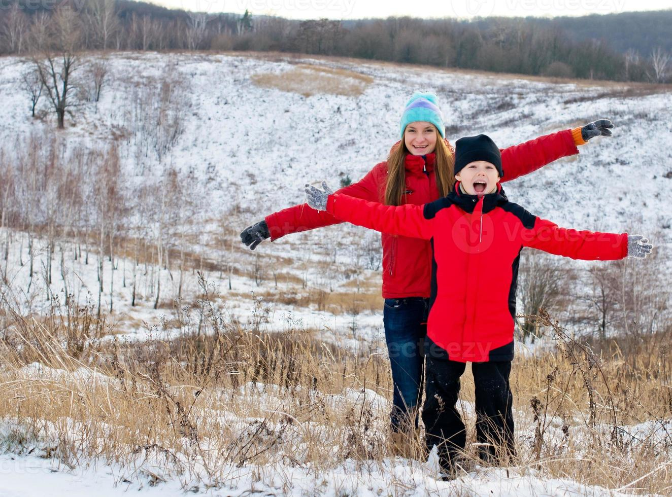 Laughing children together outdoors in winter. photo