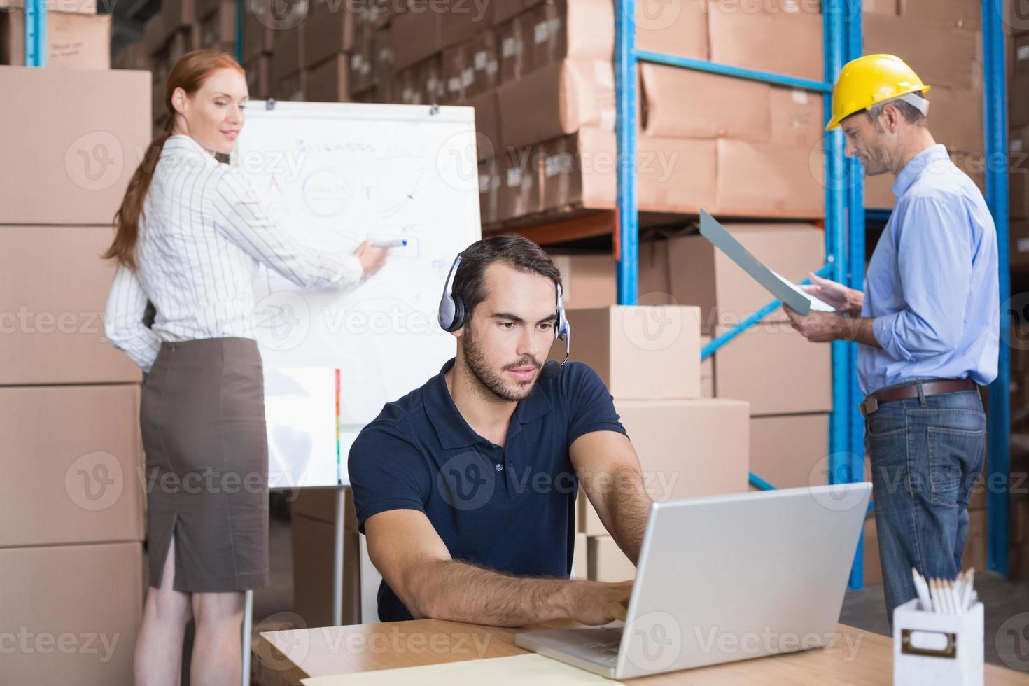 Warehouse team working together on shipment photo