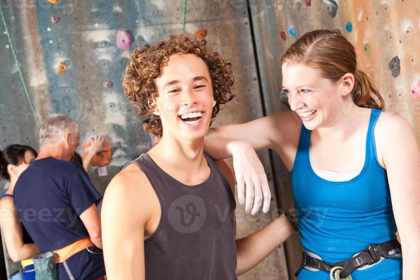 Happy rock climber friends laughing together photo