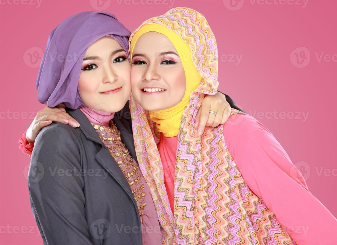 Two beautiful moslem woman having fun together photo