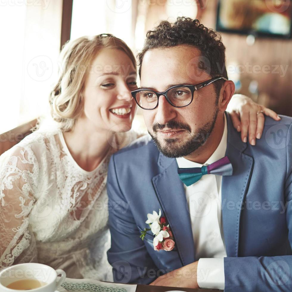 Young wedding couple in love together in cafe. photo