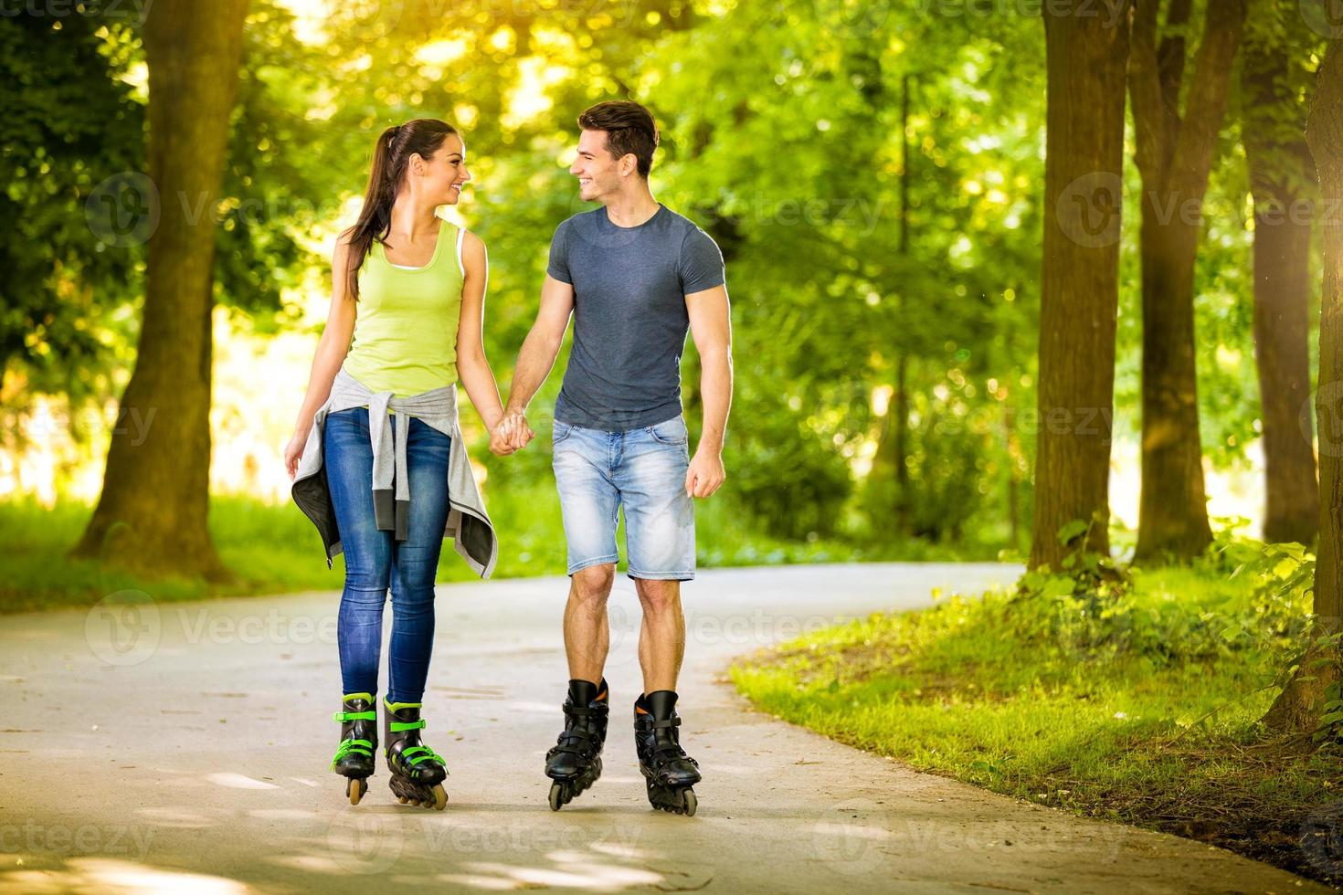 Love couple spending free time  together on roller photo
