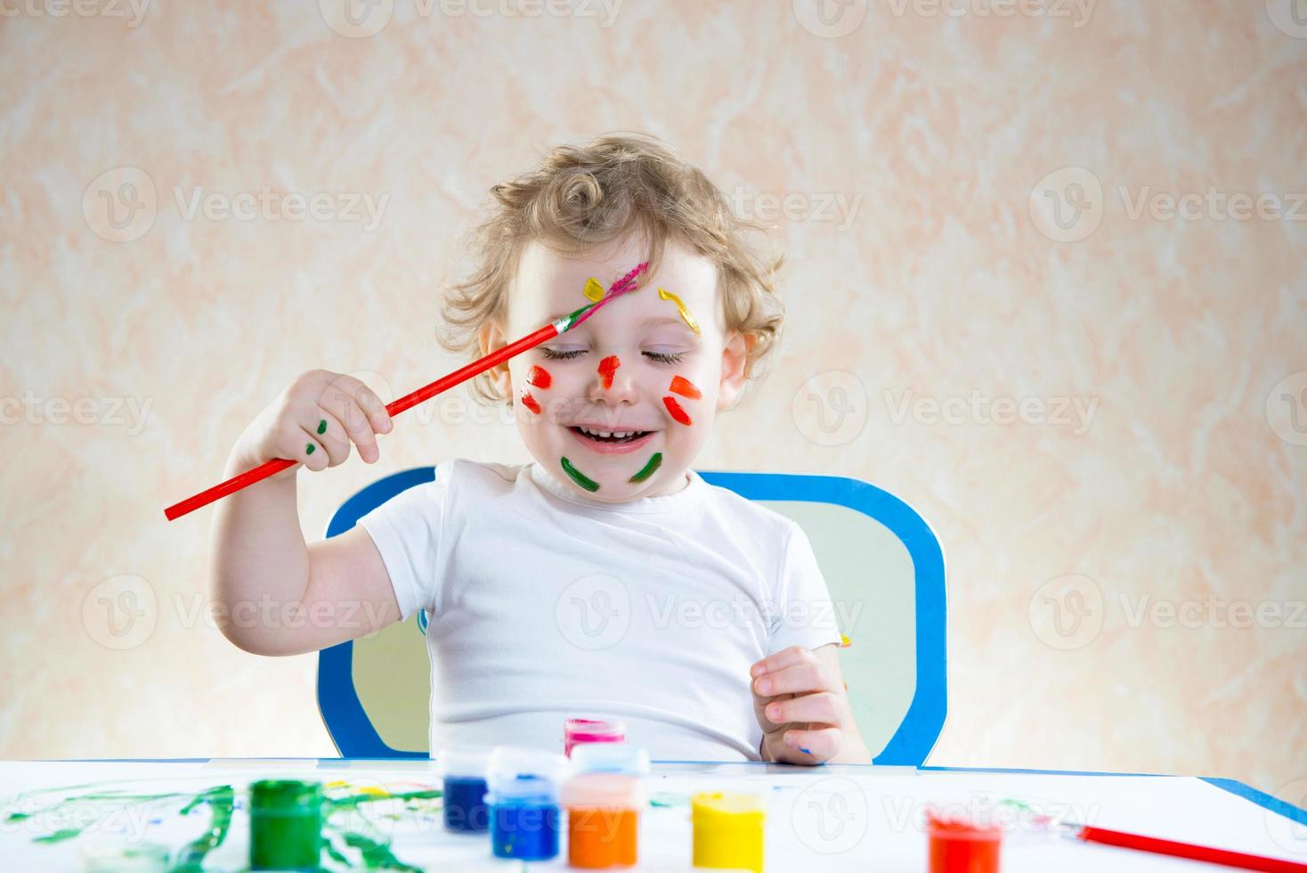 Cute little child painting photo