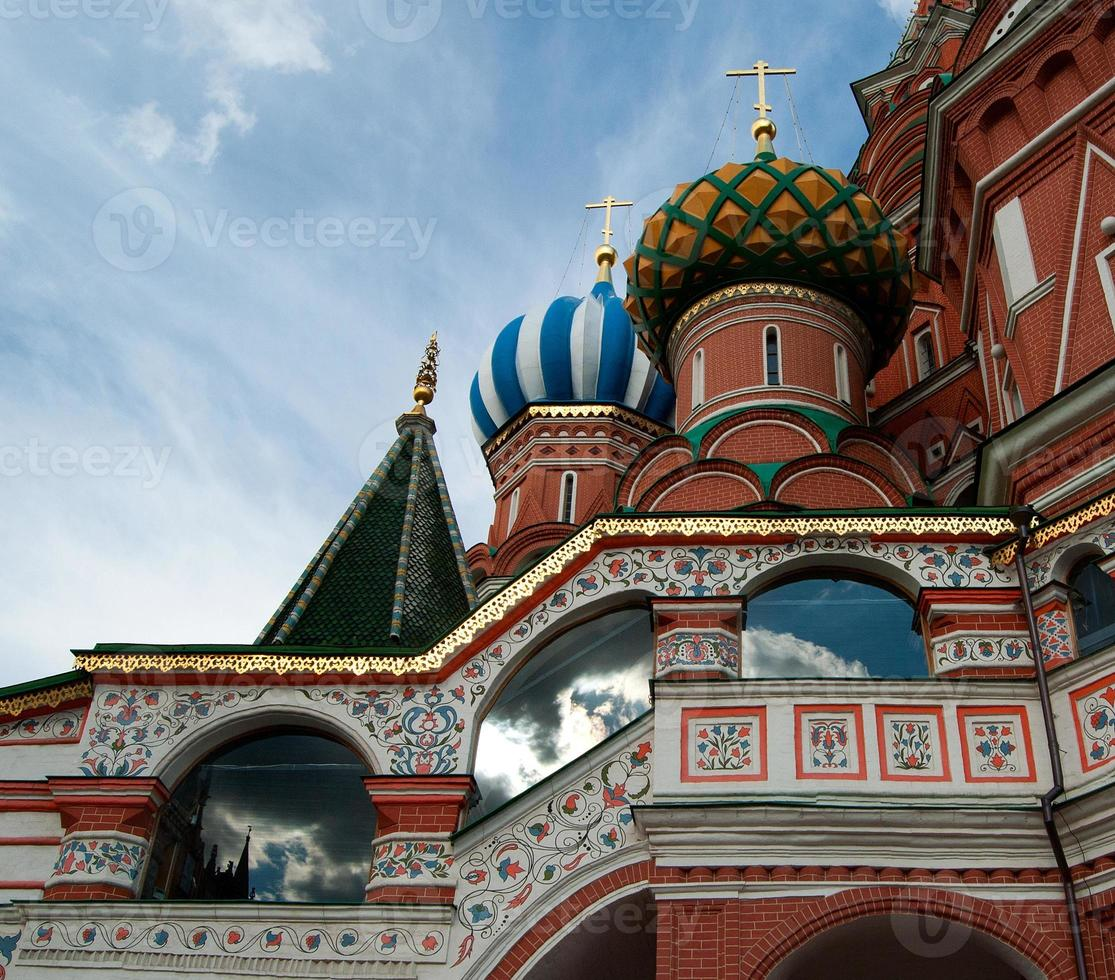 Detail of St. Basil's Cathedral with clouds reflected on windows photo