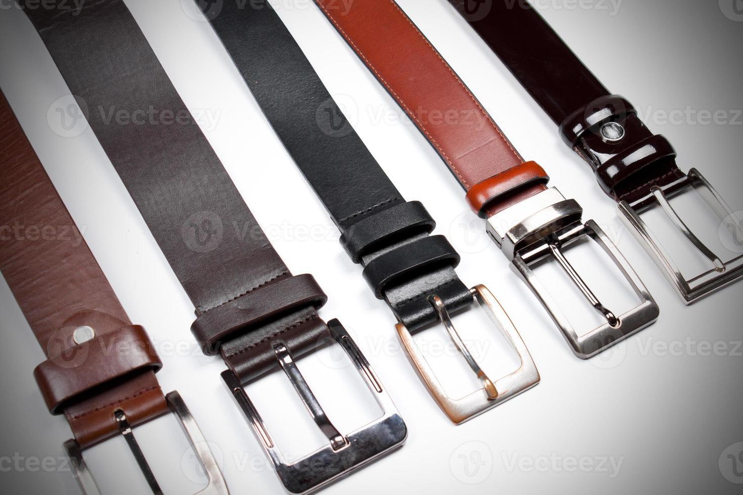 Men black belts isolated on white. photo