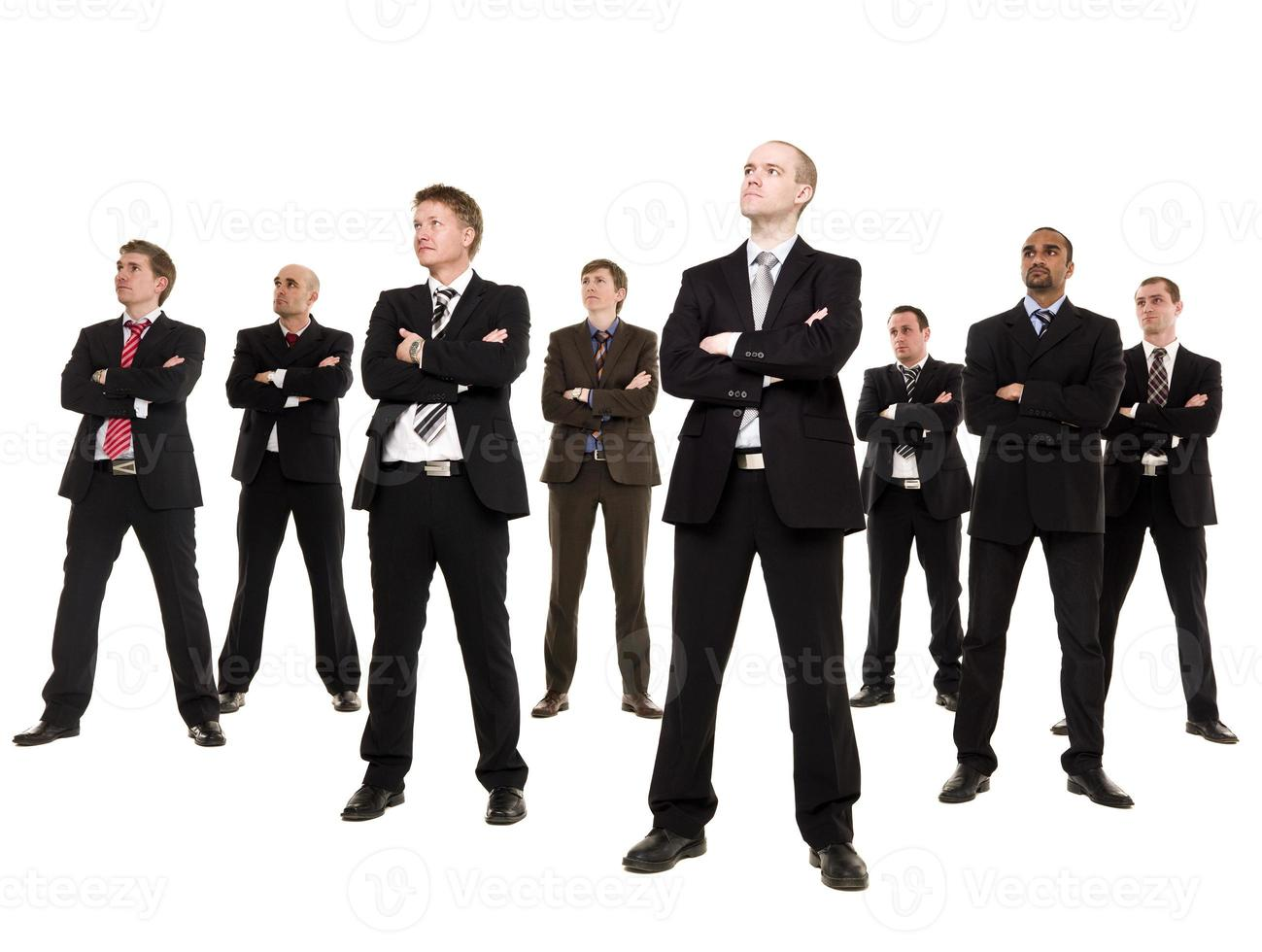Eight business men looking to side on white background  photo