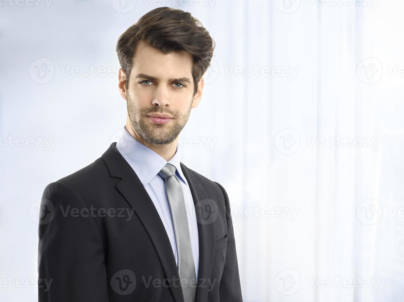 Confident young businessman portrait photo