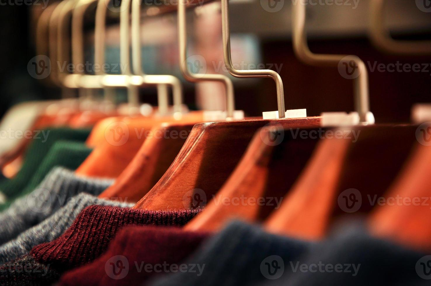 Men's clothes hung in the closet photo