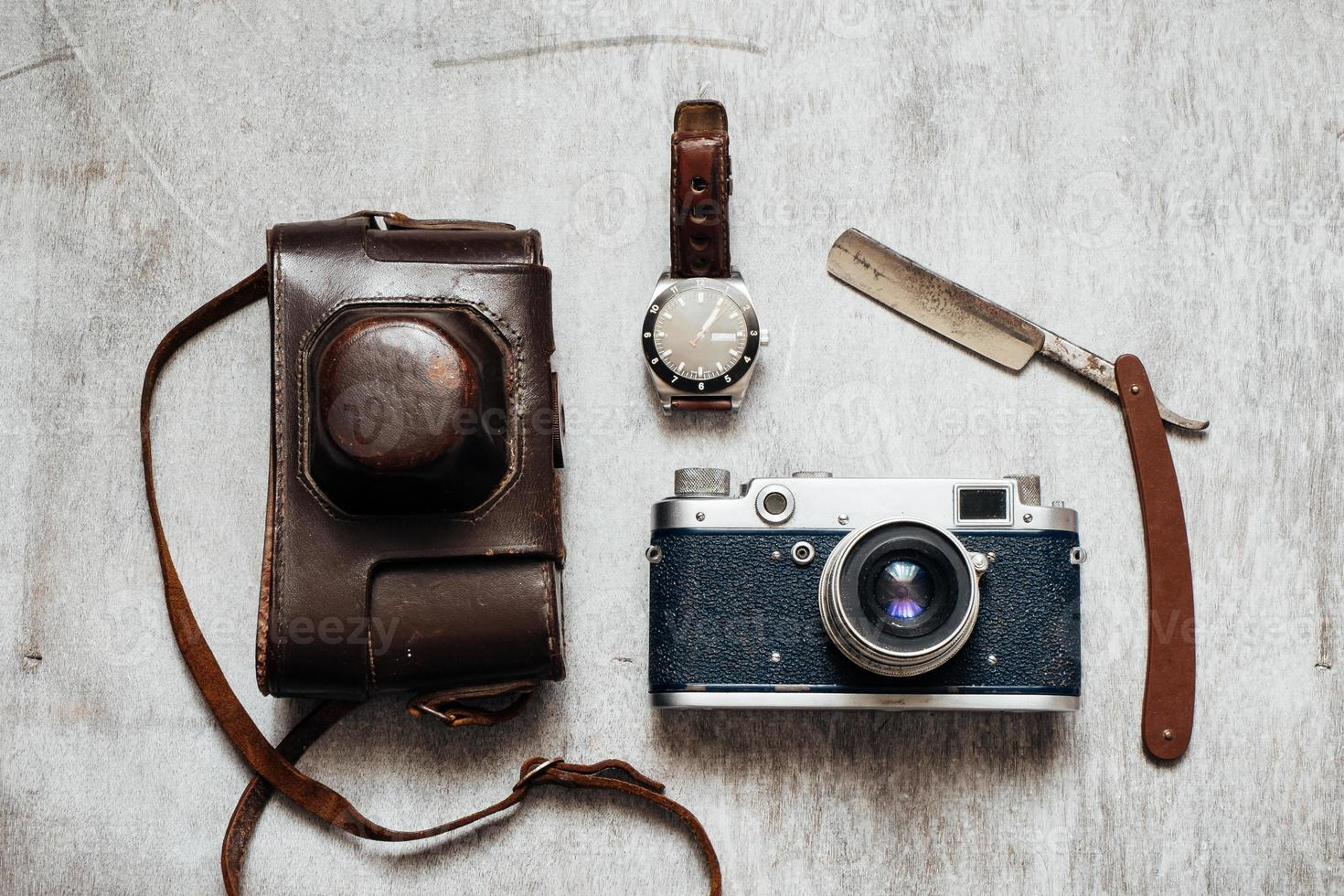 Men's Accessories , on a wooden background Retro camera watch razor photo