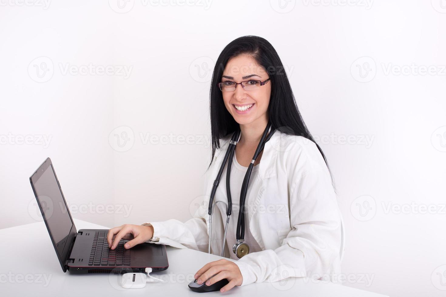 Female doctor with laptop photo