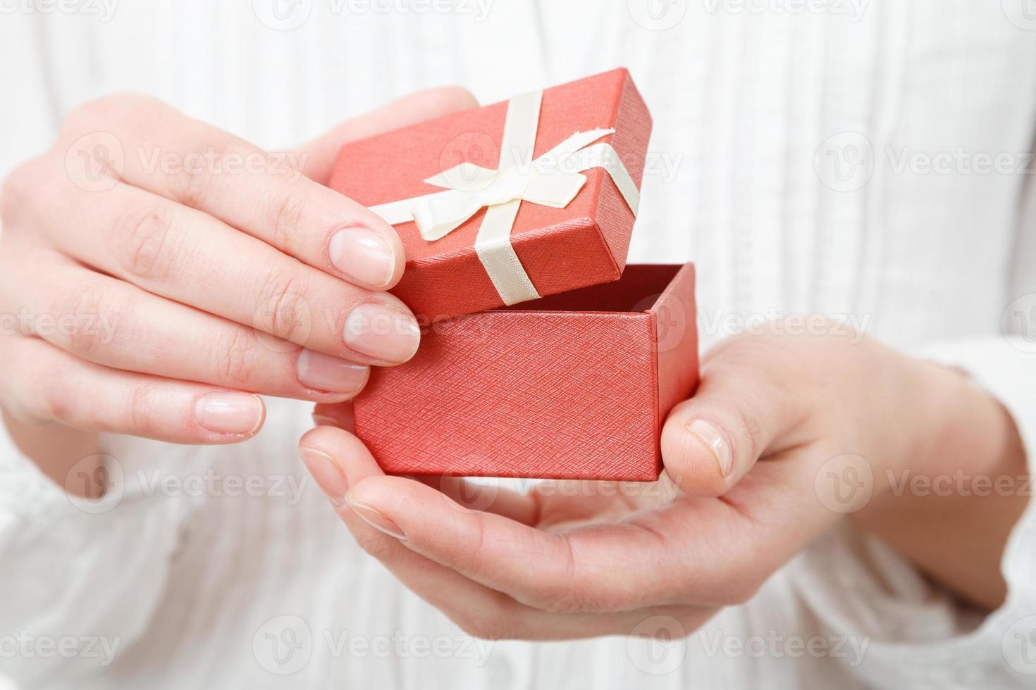 female opening gift box photo