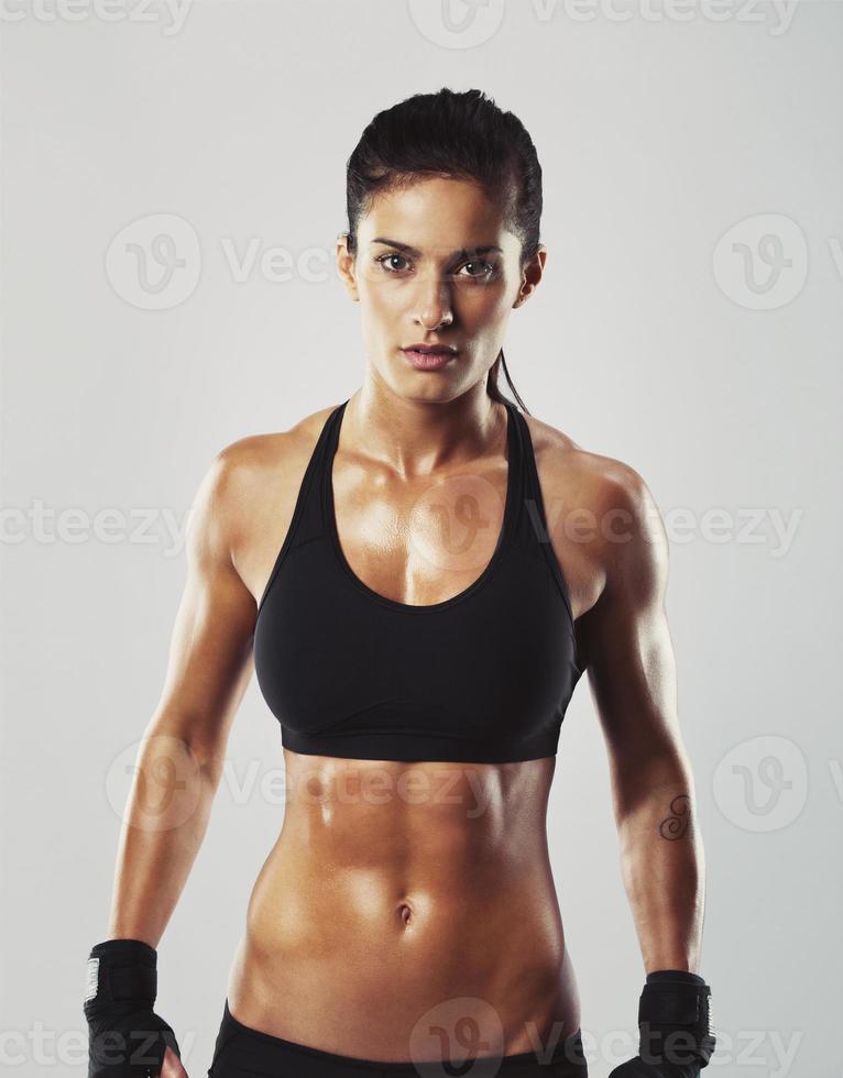 Fitness female posing confidently photo