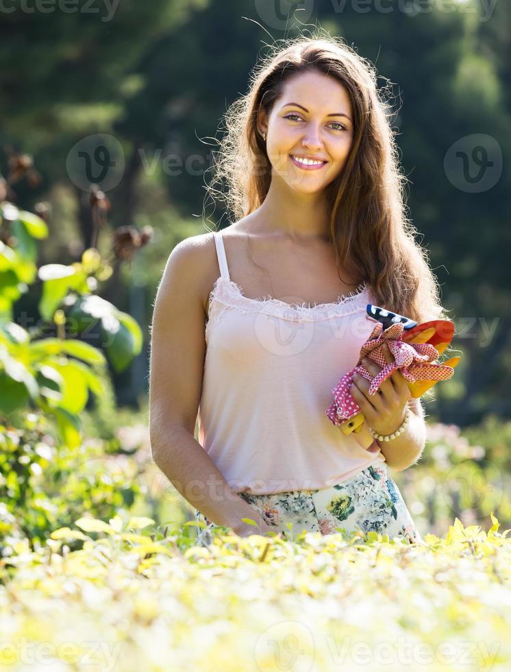 Female florist in summer garden photo