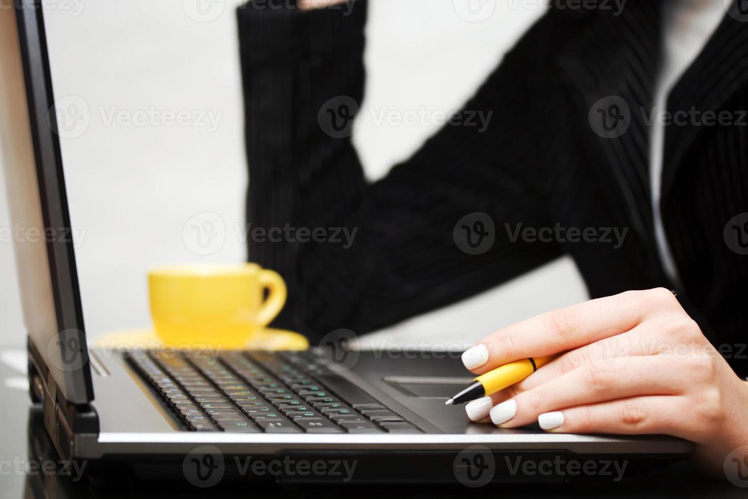 Female hands using laptop photo
