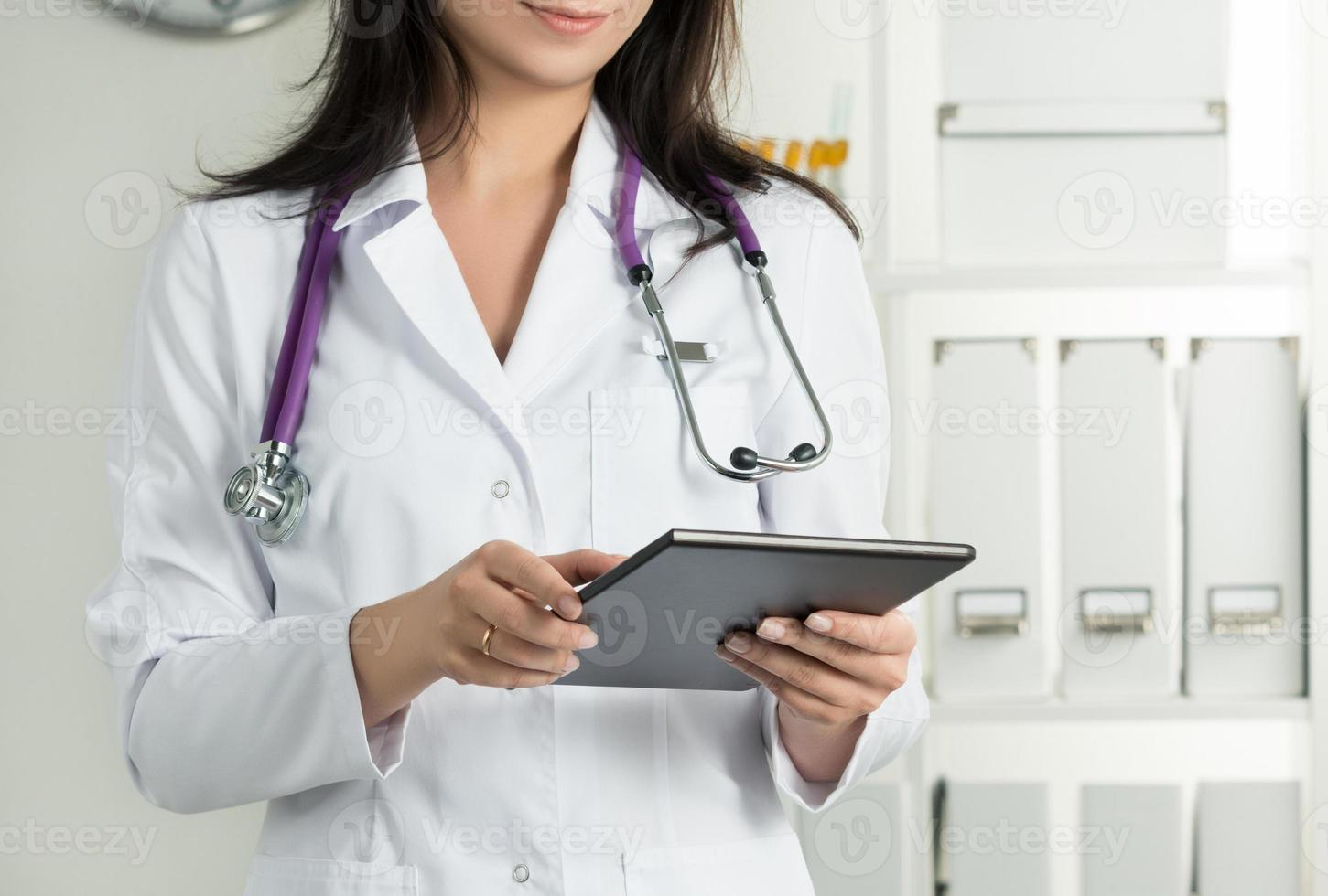 Female Doctor Holding Tablet PC photo