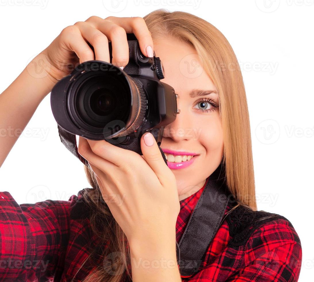 Attractive female photographer holding a professional camera photo