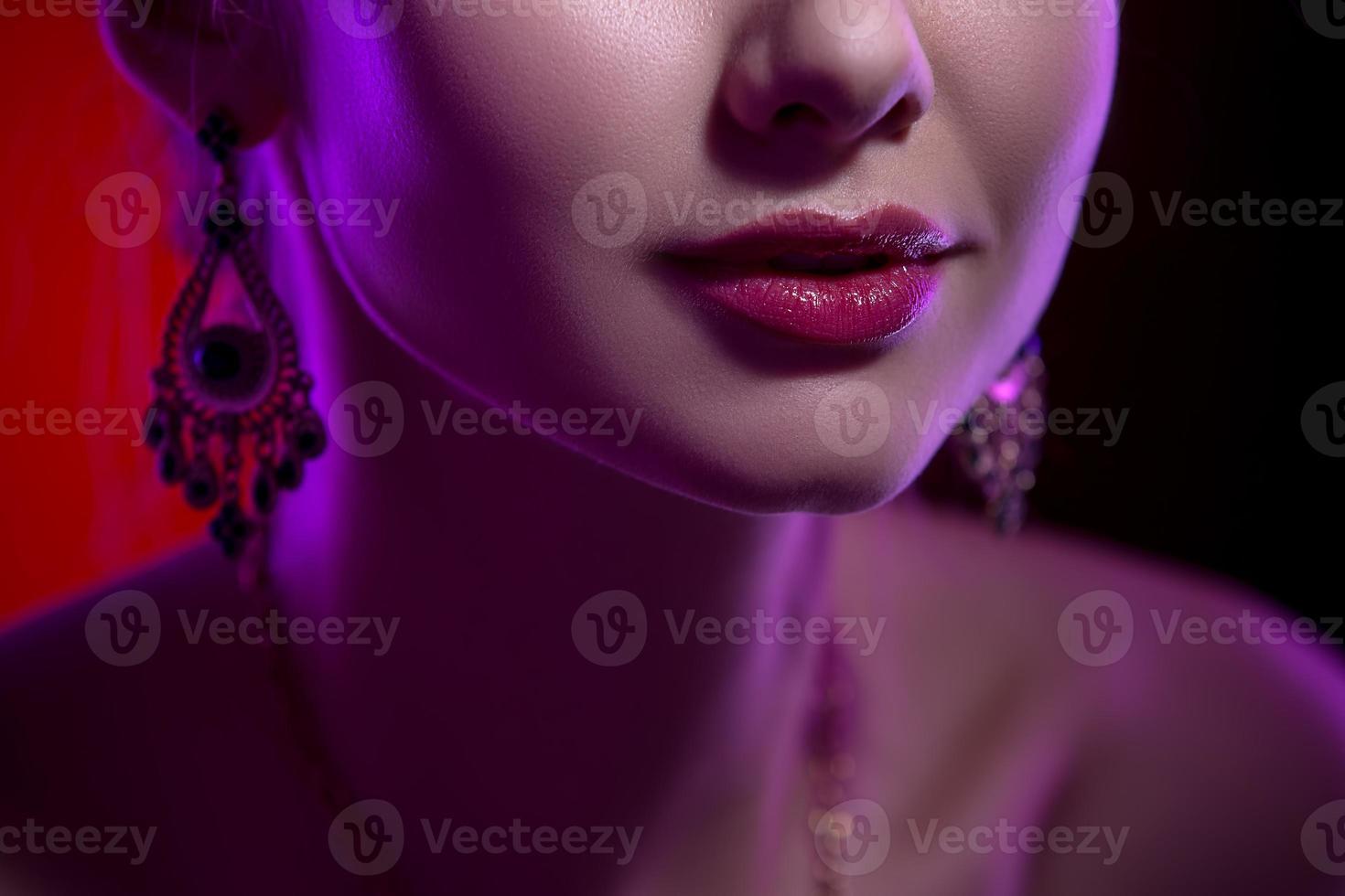 Beauty close-up portrait of female lips photo