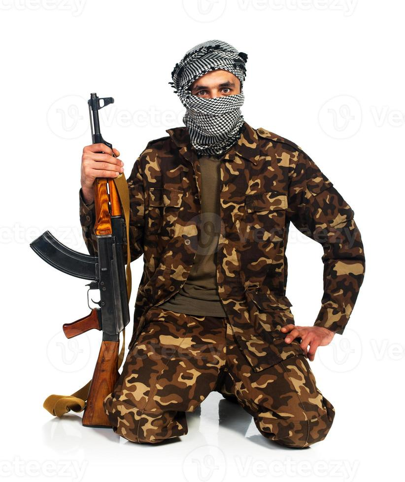 Arab nationality in camouflage suit and keffiyeh with automatic gun photo