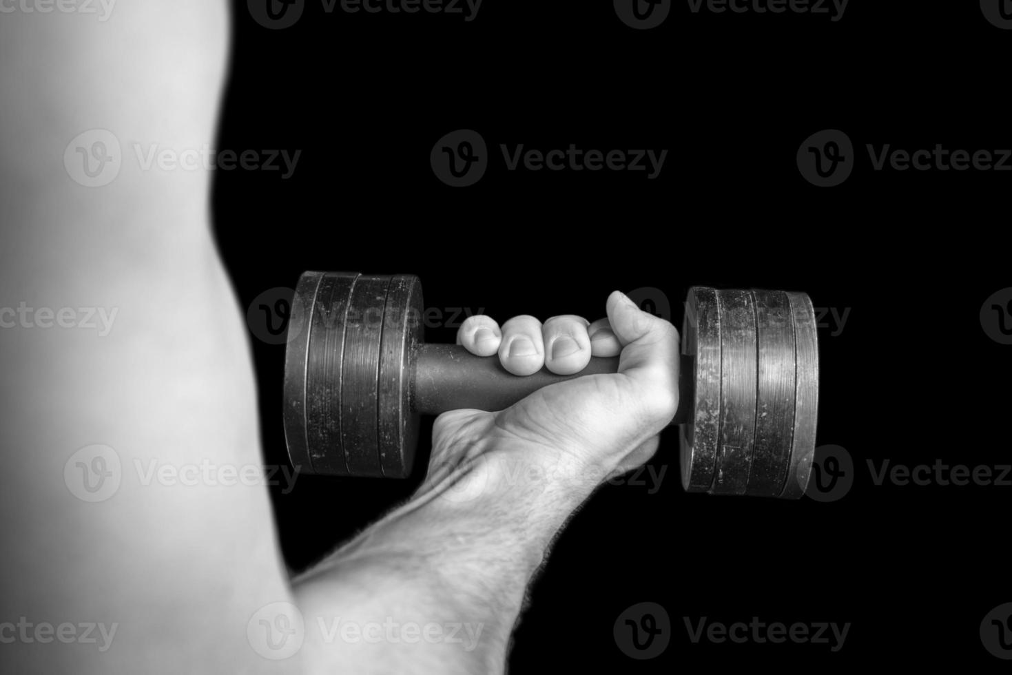 Human hand with dumbbell photo