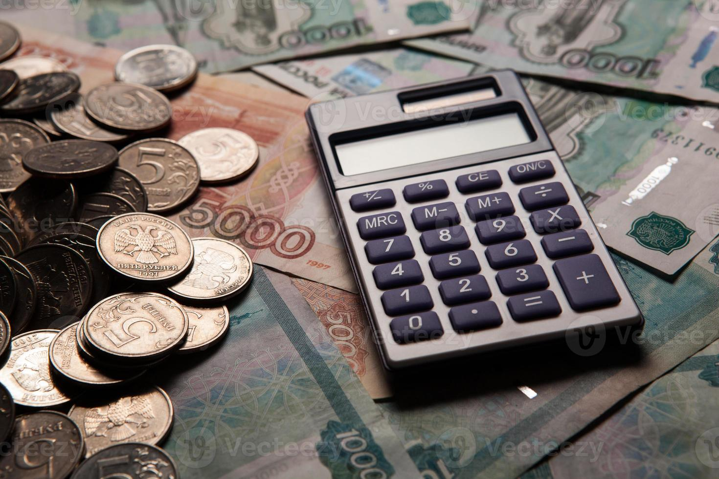 handful of Russian rubles with calculator photo